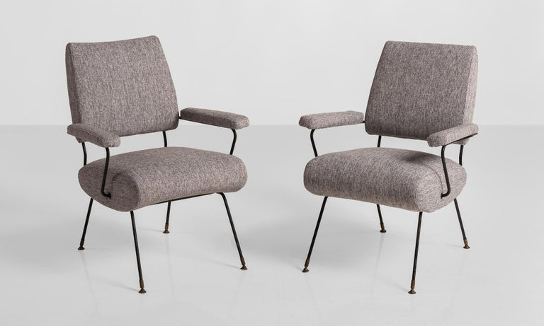 Modern Armchairs, Italy, circa 1960.  Newly upholstered with painted metal legs and supports and brass feet.