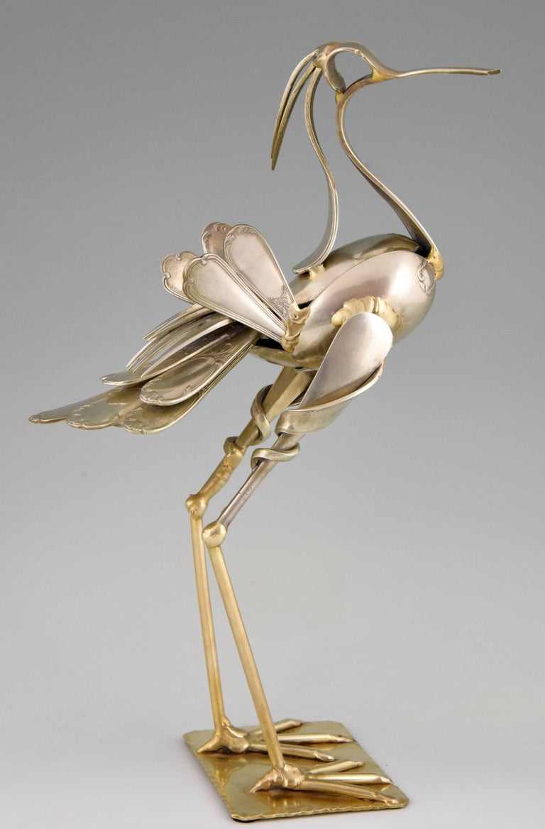 An original cutlery sculpture of a bird made of antique forks and spoons by the famous French artist Gérard Bouvier, signed and dated 1998.   Artist/ Maker: Gerard Bouvier Signature/ Marks: G. Bouvier, 98 Style: Modern. Date: 1998 Material:
