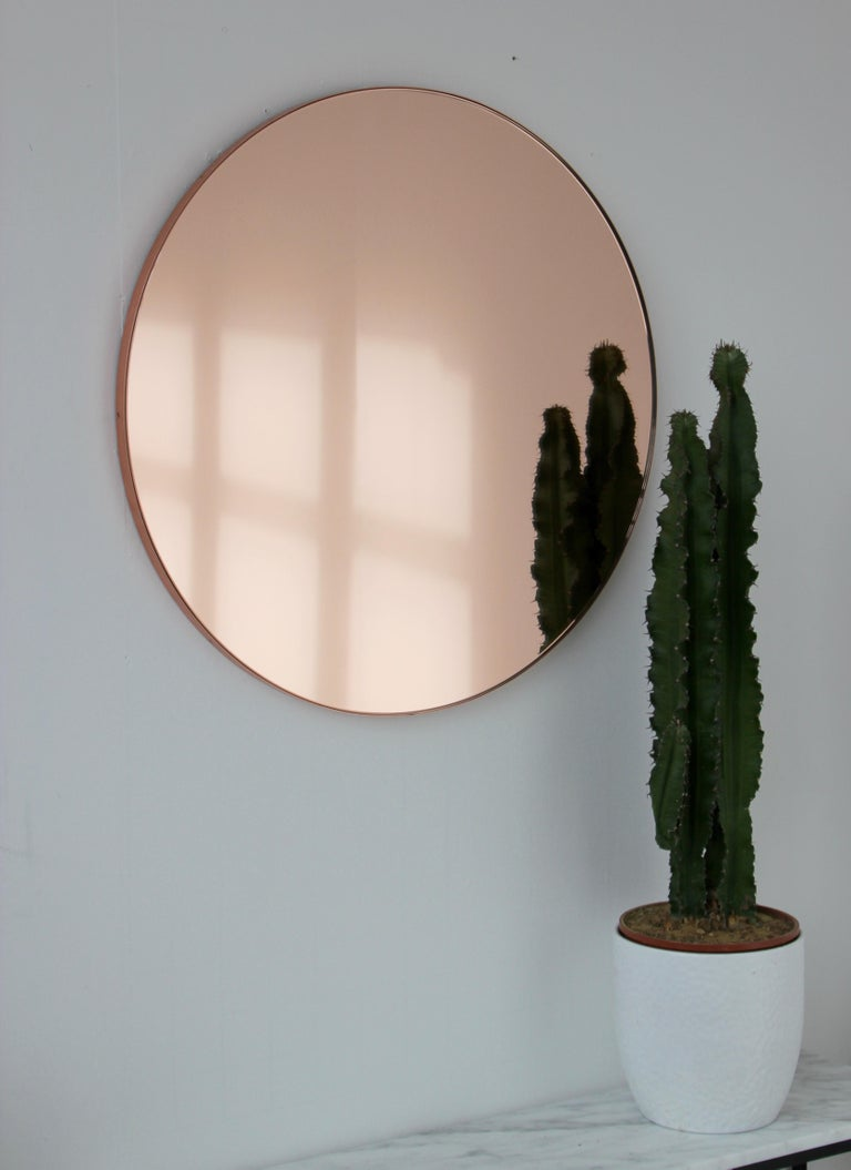 Delightful hand crafted rose gold tinted round mirror with an elegant copper frame.  Ideal above a console table in the hallway, above a beautiful fireplace, in the bedroom or in the bathroom.  Design tip: looks stunning used as a cluster in