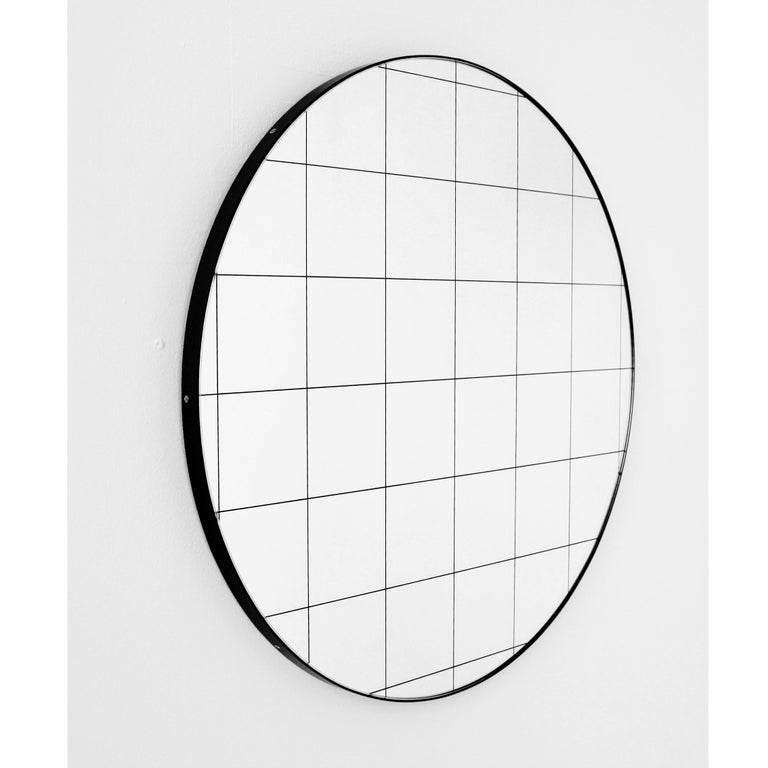 Delightful crafted silver round mirror with an elegant black frame and black grid.