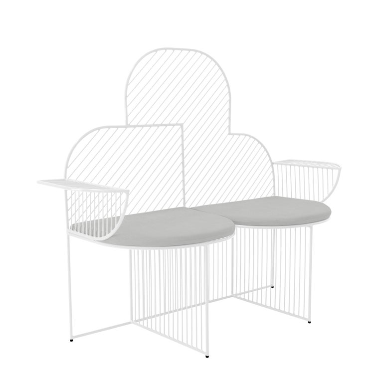 Made to inspire a smile and a photo-op, The Cloud bench is a bold, fun, and friendly wire lounge chair that sits two. With sunbrella padding and a cloud shape, this seat is perfect as outdoor garden furniture or a lounge chair for a porch or patio.