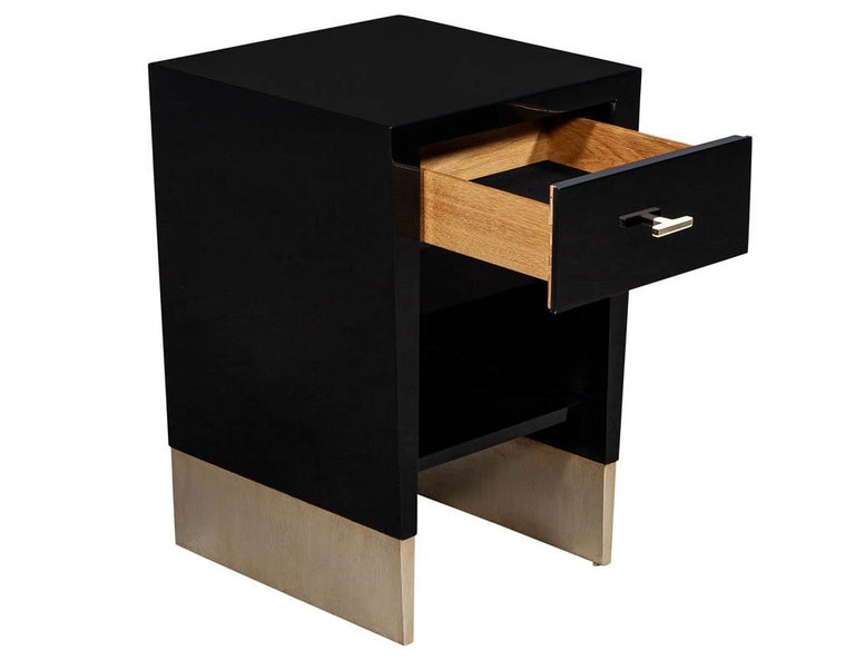Modern black lacquer end table Rachmaninov by Jacques Garcia Baker. Sleek modern design in hand polished black. Featuring sleek hardware and metal leaf foot accent.