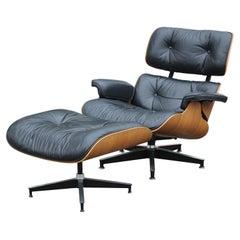Moderner Schwarzer Leder und Palisander Herman Miller Eames Loungesessel und Ottoman