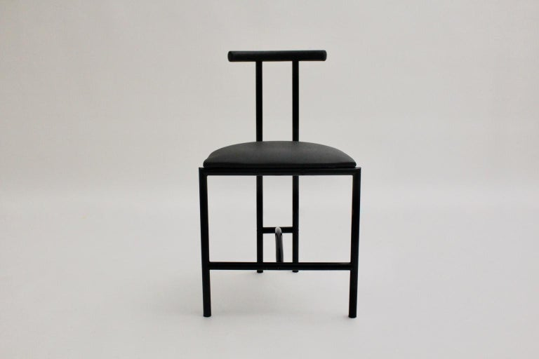 Modern vintage chair was designed by Rodney Kinsman 1985 United Kingdom and made of black lacquered tube steel and a covered seat features black faux leather. Very good vintage condition Approximate measures: Width 43.5 cm Depth 41 cm Height 74.5