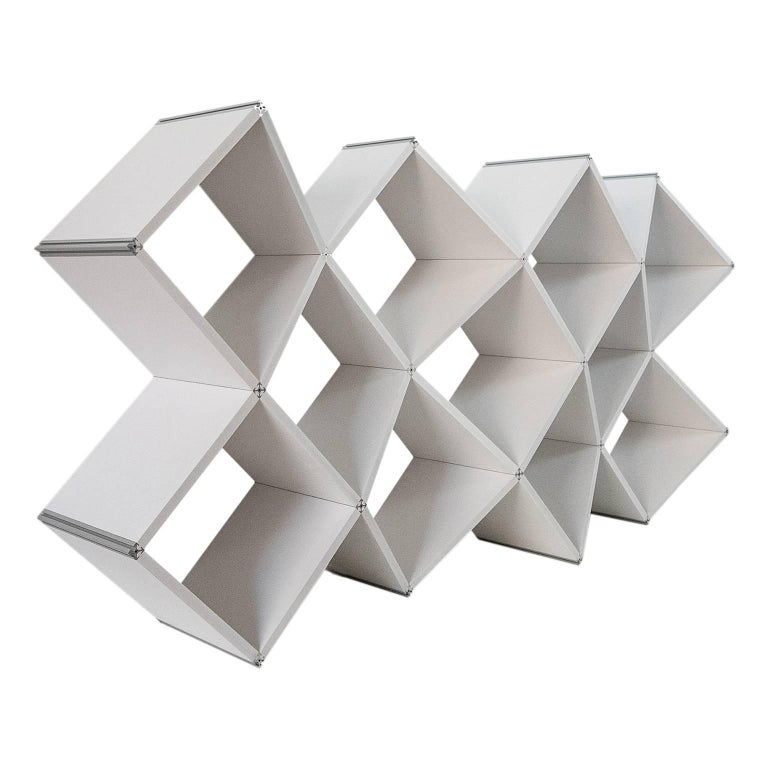 X.me is a modern bookcase, designed by Salvator-John A. Liotta (LAPS Architecture) and manufactured by MYOP, with PVC foam shelves connected by a single extruded aluminum connector. X.me fits to every types of space, wrapping them. The X is a sign,