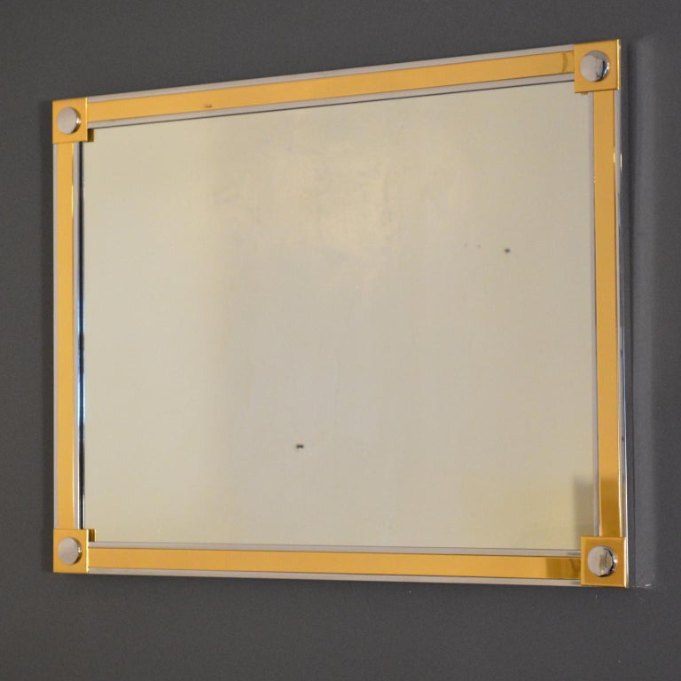 High quality mirror, clear, heavy, flaw-free, in steel frame plated with brass and chrome. Heavy-duty mounting hardware and symmetric design permit hanging in vertical and horizontal orientations. Similar in aesthetic and construction to Romeo Rega