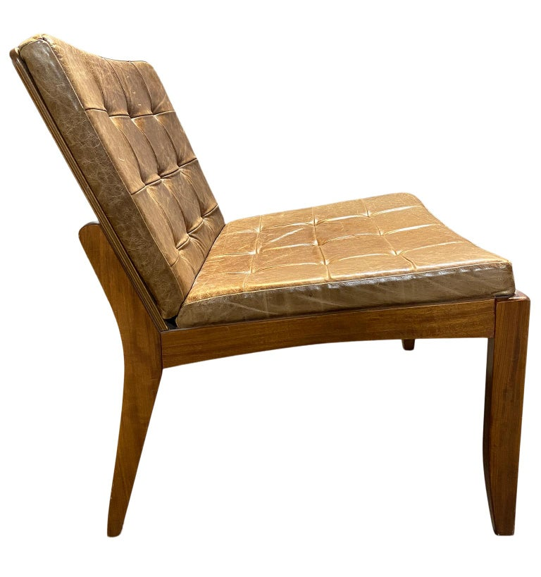Modern Brazilian brown leather low lounge chair by Fernando Jaeger. Minimalist design great lounge or side chair. Wood and leather construction. Located in Brooklyn NYC.