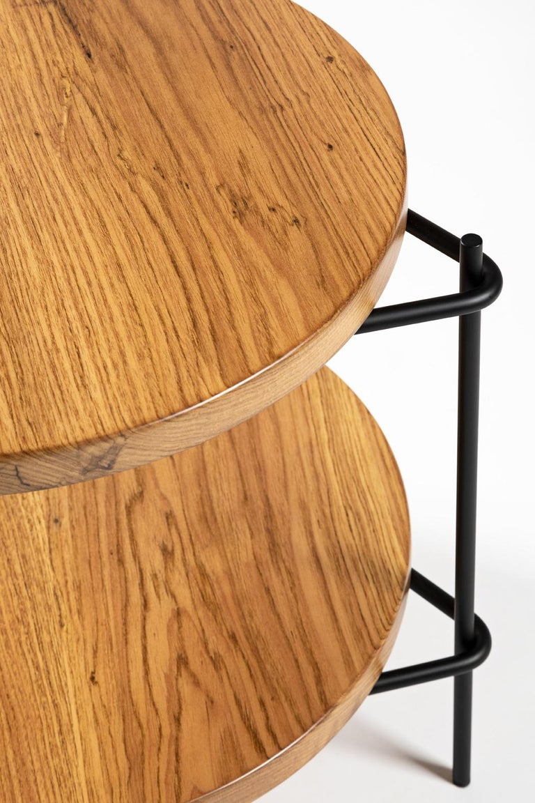 This versatile minimalist side table in solid Brazilian wood