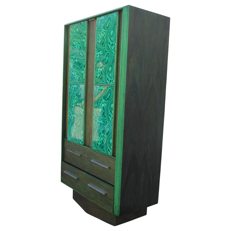 Custom green dyed walnut tall wardrobe or dresser with faux malachite panels. The dresser has two drawers and opens up to reveal more selves for storage space and another drawer inside. The dresser was restored by the Reeves Art & Design team.