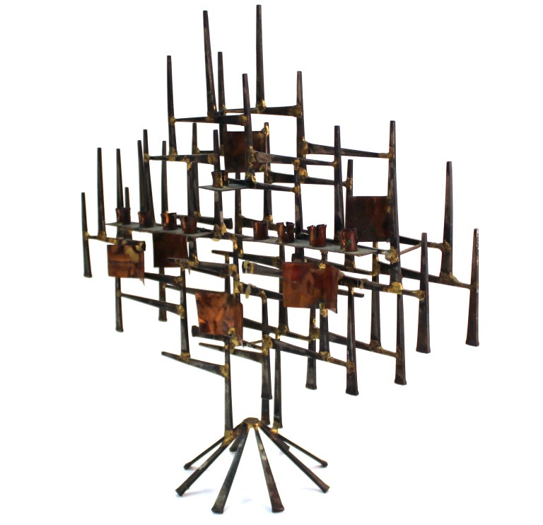Modern Brutalist period Judaica menorah made in welded metal nails. The piece was likely made during the 1970s-1980s and is in great vintage condition with age-appropriate wear and use.