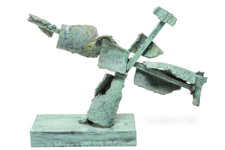 Abstract Brutalist tabletop sculpture made in an industrial green patinated steel structure of cruciform shape, mounted on a rectangular base. In great vintage condition with age-appropriate wear.