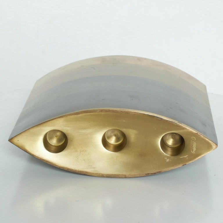 We are pleased to offer you a rare decorative object- a brass modern candlestick holder in sculptural shape. it holds three candles. Constructed with three different metals. Functions as a vase as well. Made in the USA circa the 1990s Dimensions: 8