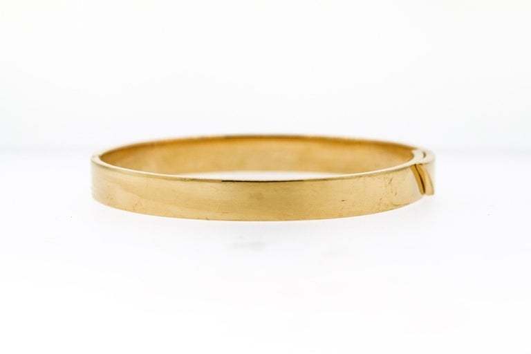 Modern Cartier Anniversary Diamond 18 Karat Gold Bangle Bracelet In Excellent Condition For Sale In New York, NY