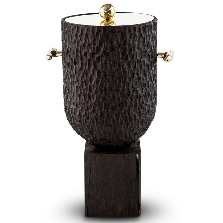 This modern ice bucket is part of the egg designs Dawa luxury bar collection and is a great addition to any home cocktail bar, or simply as a place to keep a bottle of your favorite wine cool and crisp.   The body of this handmade, bespoke wine