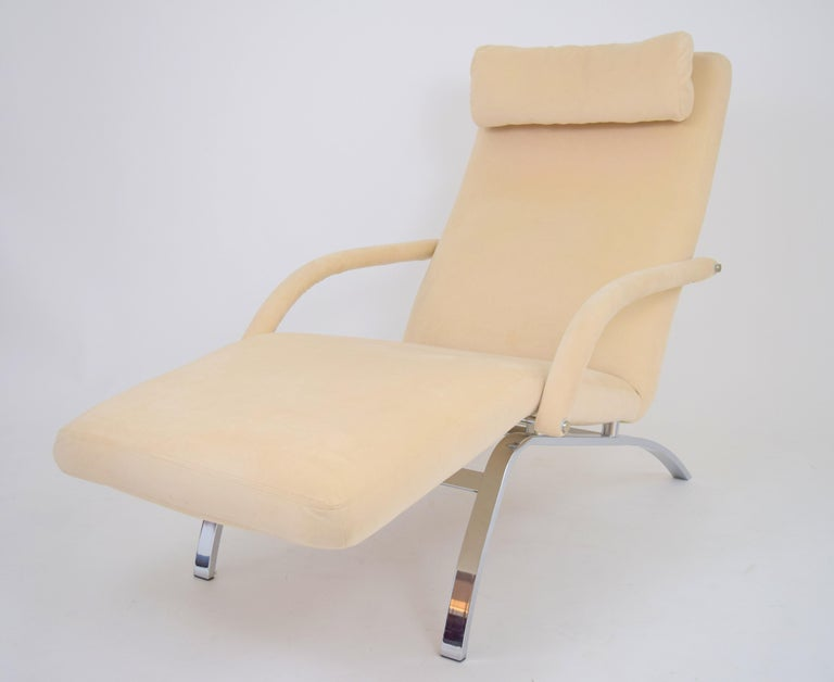 Swooping modernist chaise lounge by DIA upholstered in original cream colored Microfiber/Ultrasuede. Dynamic profile with chrome base and floating lounge frame. Retains original removable headrest pillow and manufactures label to underside.