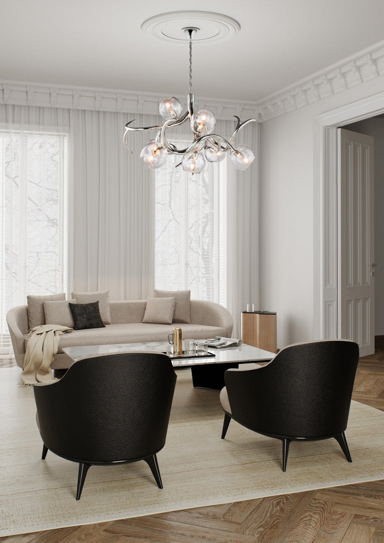The Ersa, a modern chandelier in a black matte finish with glass spheres,, is designed by William Brand, founder of Brand van Egmond. Sculptural and full of character, the chandelier is available in three different models round, conical, and oval.