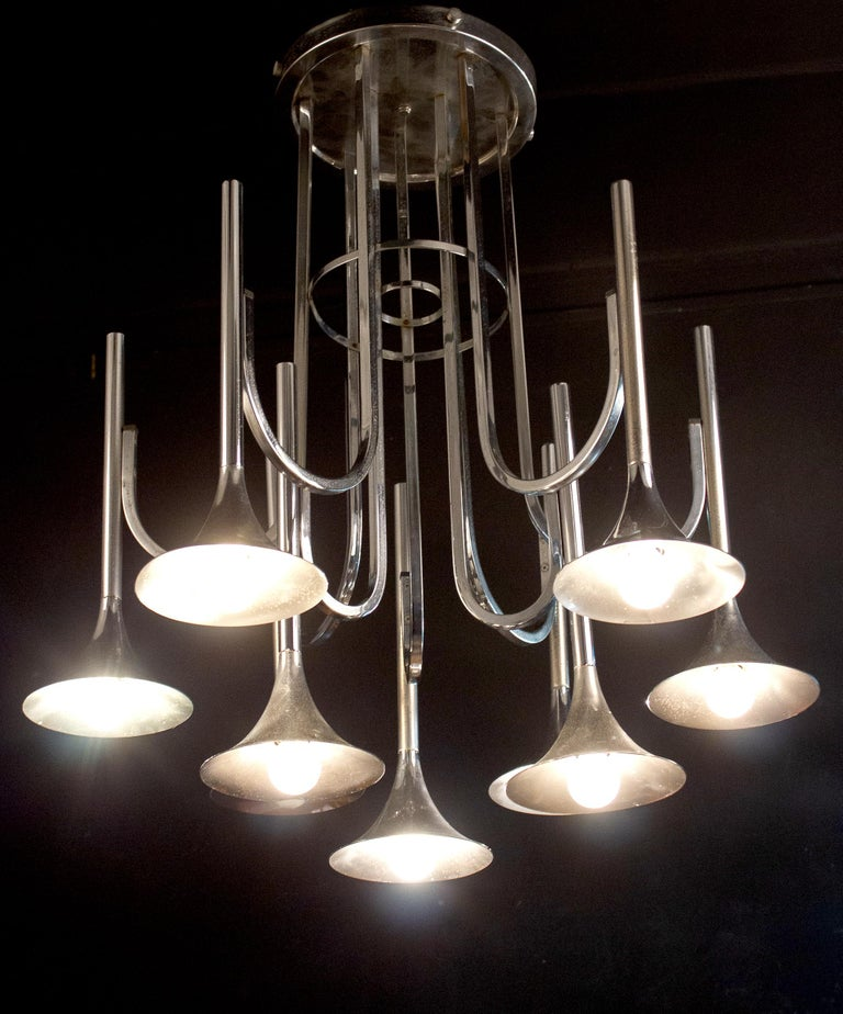 Modern style Italian Trumpet chandelier by Goffredo Reggiani Italy, 1970s. It's a 9-armed chromed pendant on two levels. The chrome of the chandelier has some age related spots due to the war of time. In good used vintage condition.  Suitable