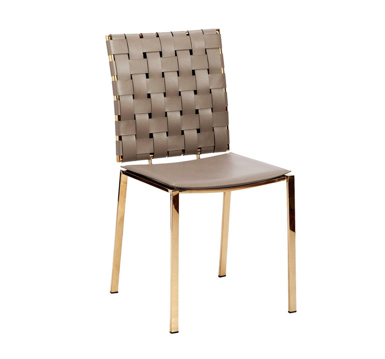 As a set of 6, these updated classics feature a premiere stainless steel frame with a polished gold finish. Each seat is upholstered in taupe leather - muted and versatile. The texture and dimensions of the woven leather back is inspired by the