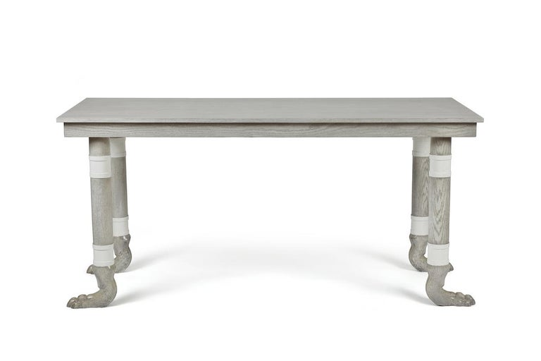 The Martin & Brockett Lupa console is named after Lupa, the she-wolf mother of Rome, this console is a modern take on a formal entry table. Shown in Italian gray with hand carved oak feet. Turned legs with white washed contrasting band