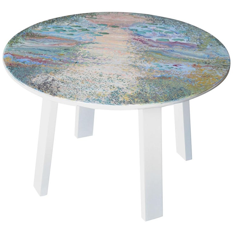 This small table made with marble top decorated entirely with scagliola, whose decoration is a tribute to the French artist Monet and resumes its famous water lilies in a rather abstract vision. The round top was deliberately made by hand leaving
