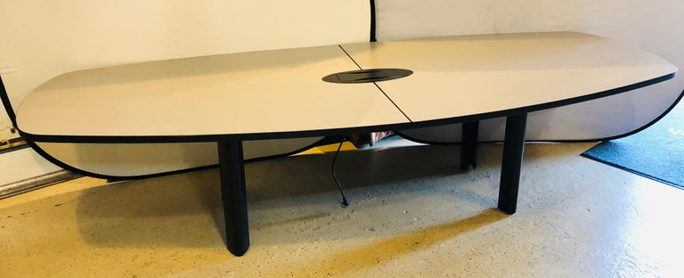 Modern conference table with electric priced for immediate sale.