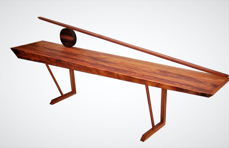 A modern style console table in hardwood. The Orum, Sun in Yoruba.  With bold shapes, Brazilian noble timbers invite the spectator to use their imagination.  Sunrise or sunset, a horizont, boats, there are no limits to travel.