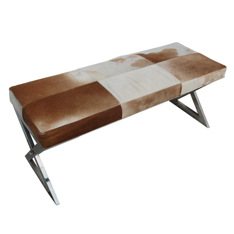 Modern genuine tan cowhide and chrome bench, gently used.