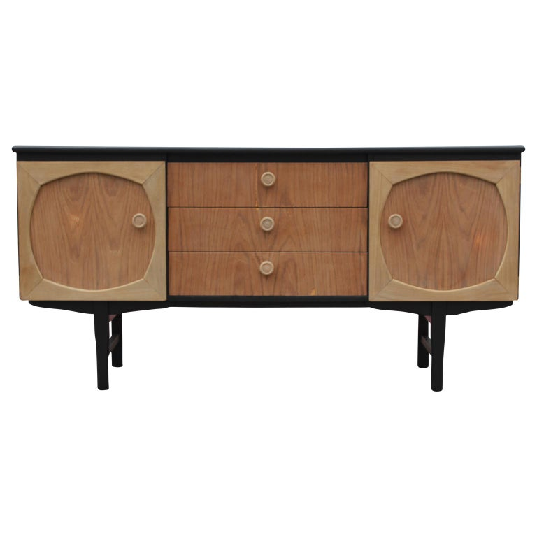 Wonderful modern Danish style custom sideboard / credenza. It has a newly completed black and natural wood finish and wooden handles. This credenza has three center drawers and two cabinet doors with one interior shelf.