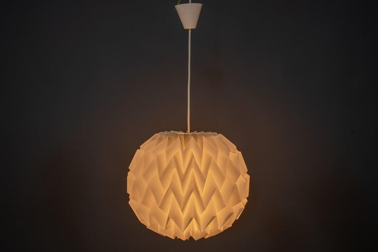 Vintage Scandinavian pendant by architect Kaare Klint (1888-1954)  Round 'Origami' shape  Metal structure illuminated from the inside, allows a play of light and an atmosphere of rare intensity. Perfectly working.