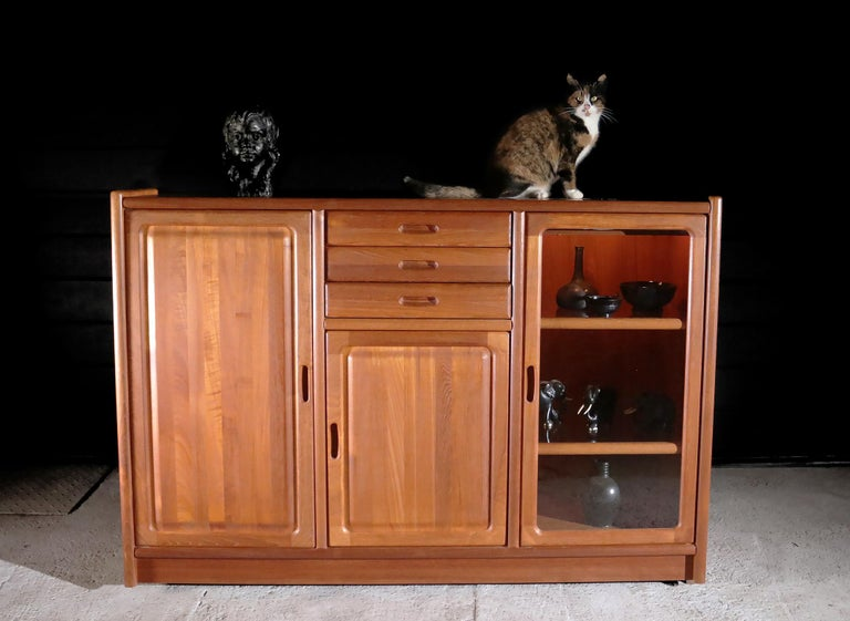 Danishs design Frederiksborg highboard made by Dyrlund in 1995. Since 1960 Dyrlund has been manufacturing furniture of the highest quality. Dyrlund's clientele can be found worldwide and includes many Heads of State, a selection of Lords, and
