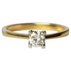 Modern Diamond an 18 Carat Gold Solitaire Ring