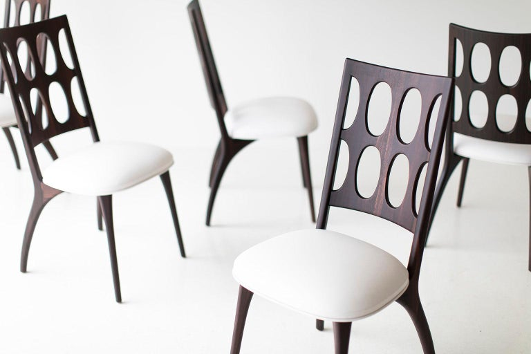 Modern dining chairs, 1901 for Craft Associates Furniture are expertly handcrafted. Each chair base is constructed by hand from hard wood. The chairs shown are in ziricote, and shaped by artisans and finished with a commercial grade matte finish.