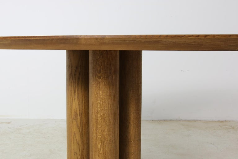 Beautiful contemporary Nathan Lindberg table, heavyweight. This piece can be used as a dining table for 6-10 persons, or as a conference table, or even a large free standing desk. Beautiful oval, elliptical shape, solid oak base. The solid oak table