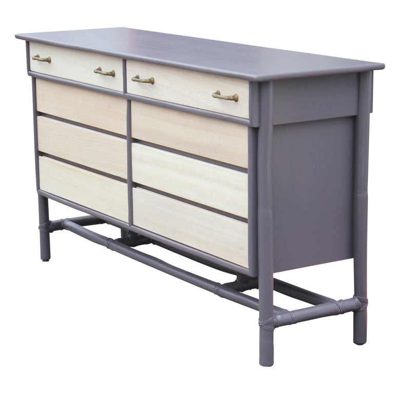 Hollywood Regency Modern Eight-Drawer Grey and Natural Dresser with Brass Handles by McGuire For Sale