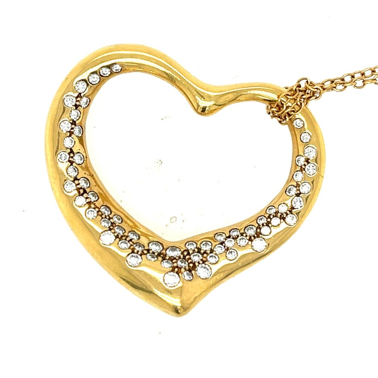 Modern large size open heart diamond pendant necklace by Tiffany & Co. designed by Elsa Peretti circa 1980. Both items are 18k yellow gold and the chain is sign Peretti as well as the heart which is signed Tiffany & Co. 18k Peretti. The long chain