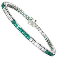 Modern Emerald Diamond and Platinum Line Bracelet