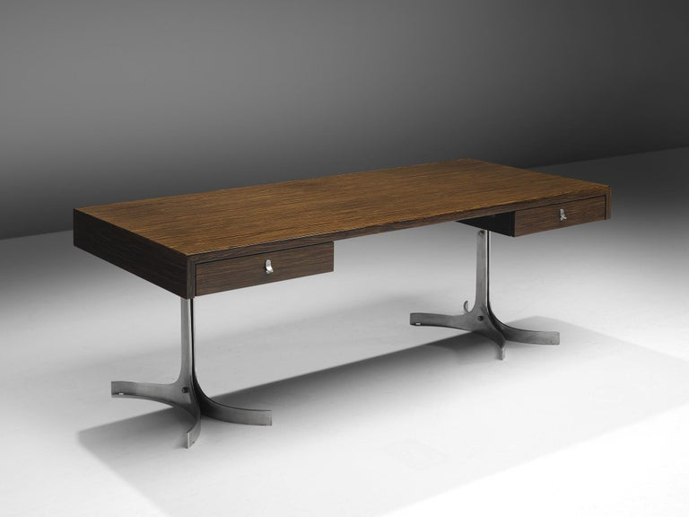 Produced by Trau Turin, writing desk, rosewood, aluminum, Italy, 1970s.  This modernist desk by Trau, Turin is equipped with two large drawers on both sides. This desk is executed in Indian rosewood and the legs and details of this piece are