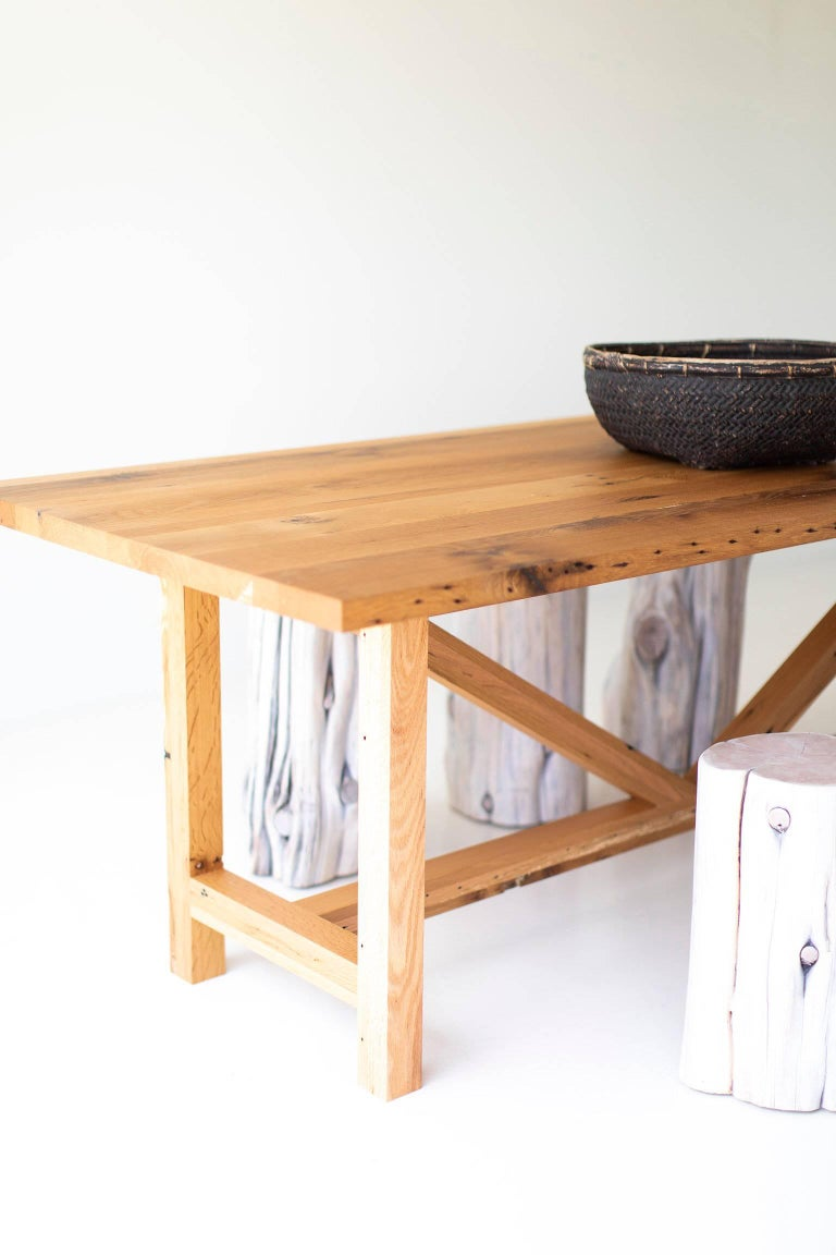 Modern farmhouse dining table for Bertu Home.  This reclaimed oak dining table is made in the heart of Ohio with locally sourced wood. We use the table both as a farmhouse dining table or desk. Each table is hand-made with solid reclaimed oak and