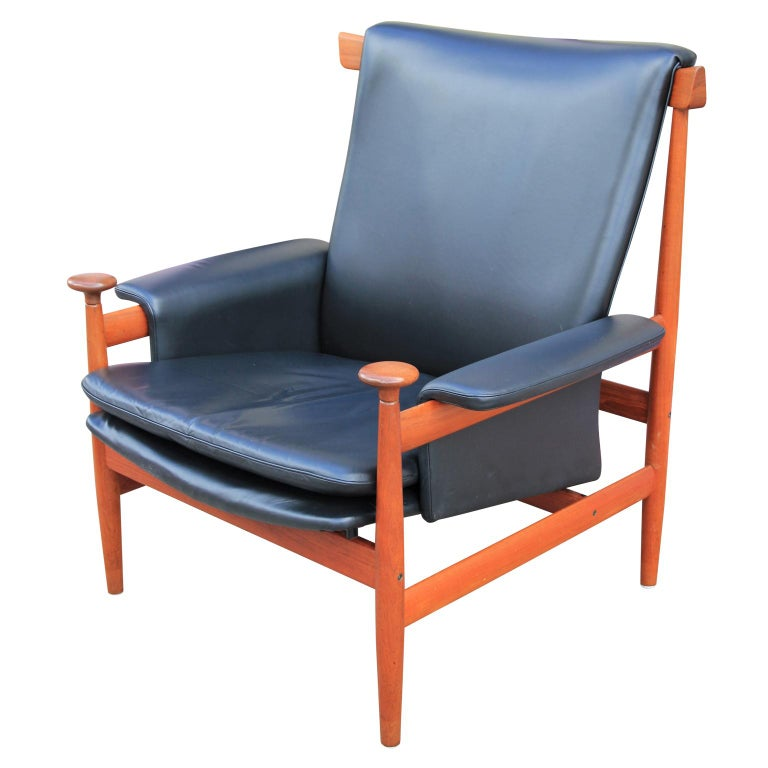 Gorgeous teak 'Bwana' chair by Finn Juhl for France & Sons in original black leather. Imported by John Stewart. There's a little tear in the back but in otherwise nice vintage condition.  The