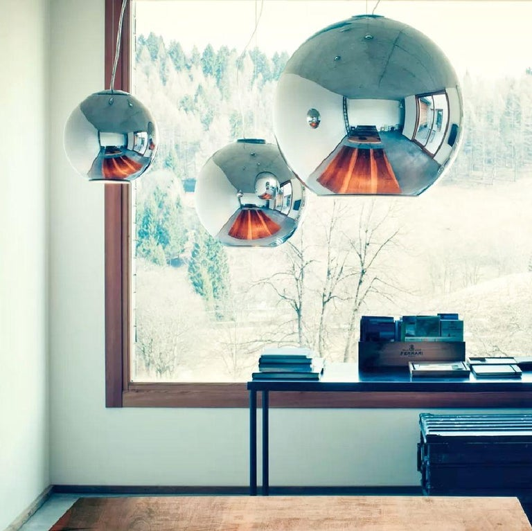 Round shape suspension lamp that radiates a direct light which originates from the heart of the lamp itself, blown glass, in chrome finish, which enhances the spherical form. This is the smaller sized suspension pendant (12