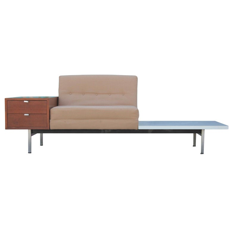 Lovely sofa by George Nelson for Herman Miller as part of their Modular Group line featuring an attached white side table and two walnut drawers. Fun and functional addition to any space.