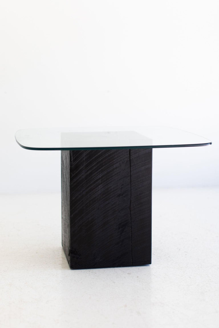 These are handmade from our family to yours! See how we do it here.  Our stumps are now kiln dried! This process helps with major cracking, moisture issues, and bugs!  This Modern Glass Top Coffee Table is made in the heart of Ohio with locally