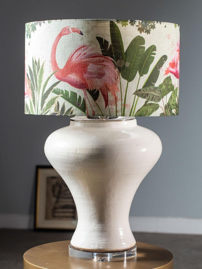 A hand made modern glazed ceramic vase vessel with a wide neck now transformed into a custom lamp. Fitted with nickel silver hardware and mounted on a circular Lucite base this custom lamp takes a standard base bulb. Now topped with a linen shade