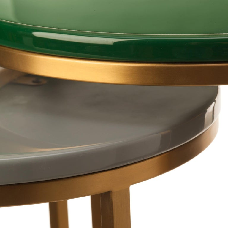 Modern glossy coffee table - Pols Potten Studio Dimensions: 76 diameter x height 40 cm Materials: Brushed gold plated, stainless steel frame, resin top   Pols Potten products are characterised by a modern twist on traditional design. Each of