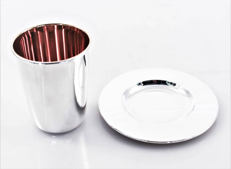 A great looking goblet (kiddush cup) and matching tray. Very modern and neat looking, with a midcentury retro look. Makes a perfect wedding or bar mitzvah gift. Give them something they'll cherish forever, give them something they'll remember you