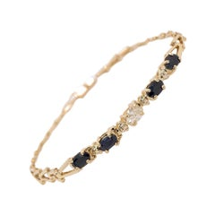 Modern Gold 0.55 Carat Natural Colorless Oval Diamond and Sapphire Gem Bracelet