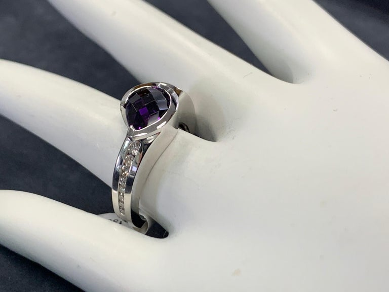 Modern 14k White Gold 1.55 Carat Natural Purple Amethyst (1.40 ct) & Diamond (.15ct)  Cocktail Ring.   The ring weighs 7.6 grams and is a size 6.25.