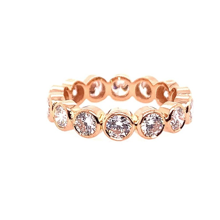 Gorgeous hand made round brilliant diamond band (size 5.75) set in 18k rose gold.  The 14 diamonds are 3.5mm diameter and are collection quality. Most are approximately E-F in color and VS in clarity.