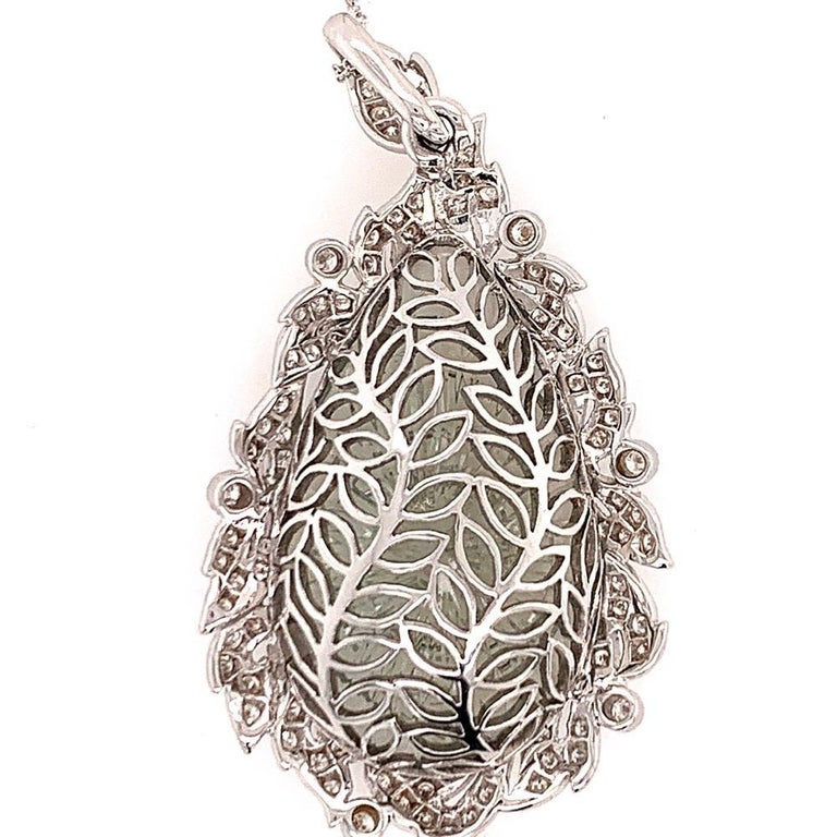 Modern 18k Gold 40.34 Carat Natural Hand Carved Green Amethyst Gem & Diamond Pendant.  The piece weighs 19.54 grams without the chain, the chain is not included.