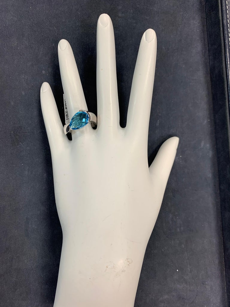 Modern 14k White Gold 4.15 Carat Natural Pear Shaped Blue Topaz Cocktail Ring.   The ring weighs 7.2 grams and is a size 6.5.